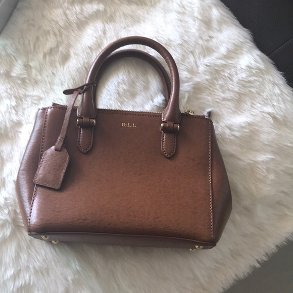 Ralph Lauren camel colored crossover bag. M 5ab7bf1950687ccf0a61eae3 1fc8be6a10d95